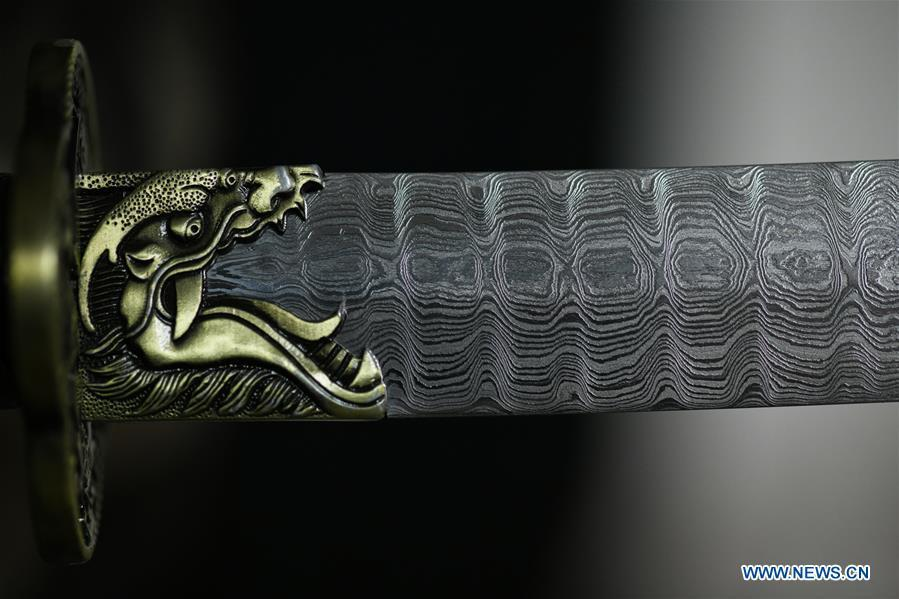 Photo taken on Nov. 14, 2018 shows welded patterns on a decorative sword made by Li Zhujun in Tiejiangzhuang Village of Xingtang County, Shijiazhuang, north China\'s Hebei Province, Nov. 14, 2018. For centuries, Tiejiangzhuang Village has been famed for its skillful blacksmiths and prosperous steel making industry. Li Zhujun is one of the village\'s top steel makers. Based on the skills inherited from his father, Li gained an expertise in the steel-making technique \