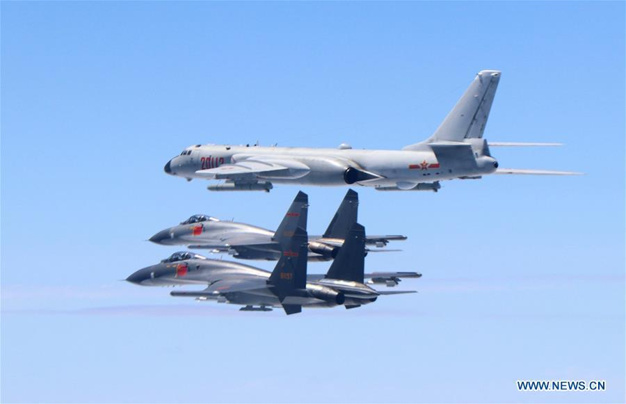 Two J-11 fighter jets and a H-6K bomber fly in formation on May 11, 2018. The Chinese Air Force announced a roadmap for building a stronger modern air force in three steps. The building of a stronger modern air force is in line with the overall goal of building national defense and the armed forces, Lieutenant General Xu Anxiang, deputy commander of Chinese Air Force, said at a press conference on celebrating the 69th anniversary of the establishment of Chinese Air Force held in Zhuhai, south China\'s Guangdong Province, Nov. 11, 2018. (Xinhua/Shao Jing)