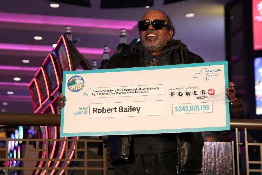 "Robert Bailey,67, holds a copy of his winning numbers before receiving his check for $343.8 million from the October 27, 2018 Powerball drawing in the Queens borough of New York, U.S., November 14, 2018. The retired federal government employee says he has ""faithfully"" played numbers that a family member gave him over 25 years ago.(Photo/Agencies)"