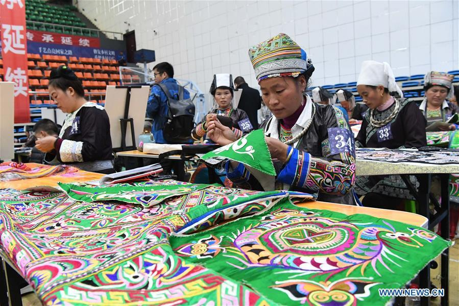 Competitors present embroidery skills during a manual skills competition held in Rongjiang County of Qiandongnan Miao and Dong Autonomous Prefecture, southwest China\'s Guizhou Province, on Nov. 15, 2018. A number of artisans from the county participated in the competition in aspects of spinning, weaving, wax printing, embroidery and so on. (Xinhua/Wang Bingzhen)