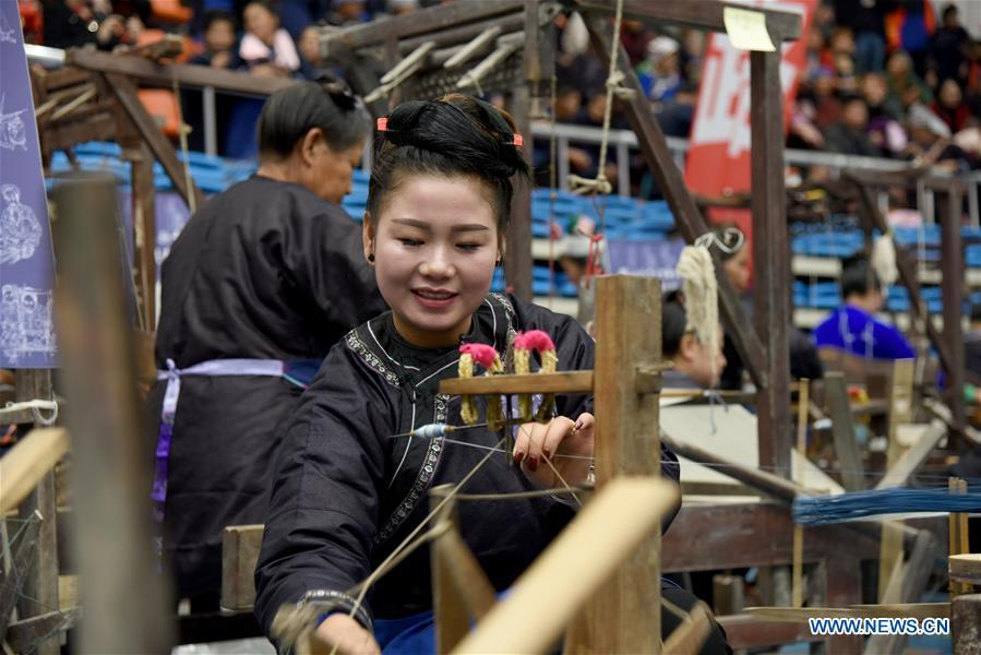 A competitor presents spinning skills during a manual skills competition held in Rongjiang County of Qiandongnan Miao and Dong Autonomous Prefecture, southwest China\'s Guizhou Province, on Nov. 15, 2018. A number of artisans from the county participated in the competition in aspects of spinning, weaving, wax printing, embroidery and so on. (Xinhua/Liu Jinyin)