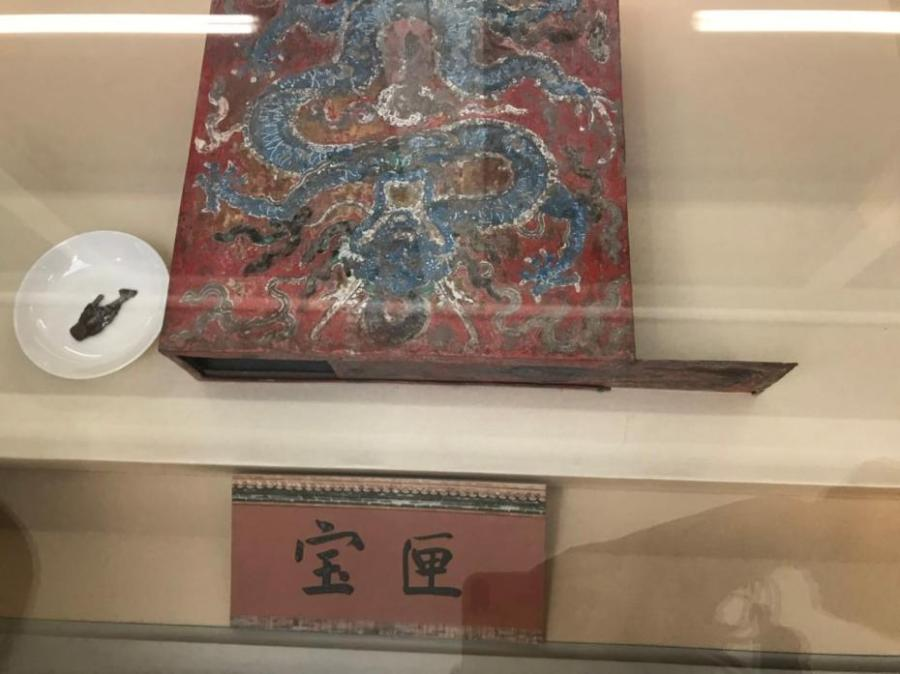 "The photo shows ""baoxia"", or ancient treasure box once placed in the Hall of Mental Cultivation in the Palace Museum in Beijing. The treasure box, made of tin and oblate in a square shape, was the first painted treasure box discovered in the Forbidden City. The box was contained many things inside, including scriptures, coins, shoe-shaped ingots in five materials of gold, silver, copper, iron, and tin, gems in five colors, satins in five colors, silk threads in five colors, five spices, five medicines and five cereals. Such boxes were placed in the ridge cylinder in the center of the main ridge on the roof as an item for suppressing evil. During ancient times, placement of the treasure box featured a grand ceremony to pray for safety.(Photo provided to China News Service)"