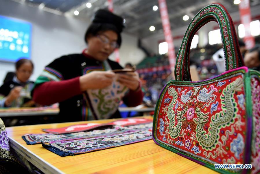 Photo taken on Nov. 15, 2018 shows embroidery works at a manual skills competition held in Rongjiang County of Qiandongnan Miao and Dong Autonomous Prefecture, southwest China\'s Guizhou Province. A number of artisans from the county participated in the competition in aspects of spinning, weaving, wax printing, embroidery and so on. (Xinhua/Liu Jinyin)