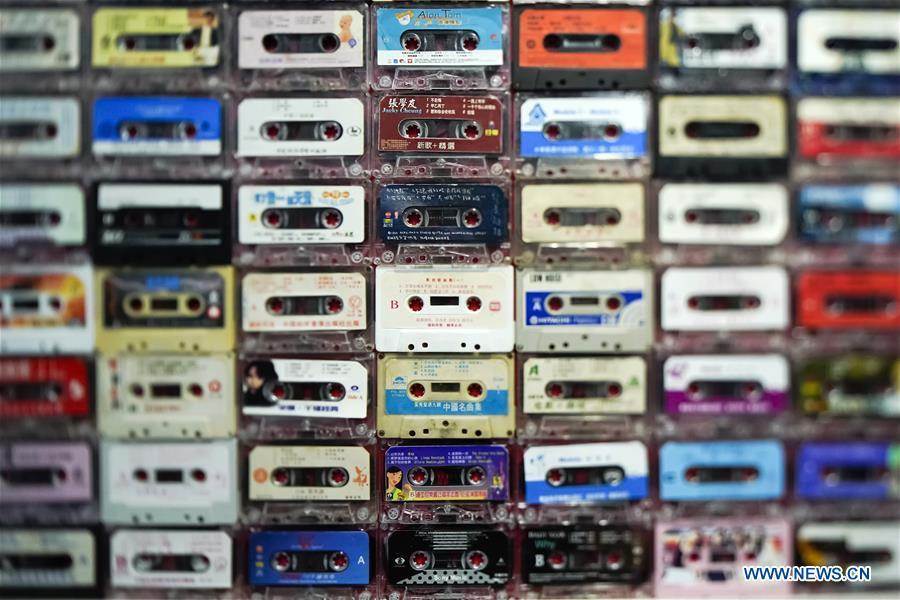A wall of vintage cassettes is displayed at a major exhibition to commemorate the 40th anniversary of China\'s reform and opening-up at the National Museum of China in Beijing, capital of China, Nov. 15, 2018. Vintage objects are displayed at the exhibition which opened here on Tuesday to show visitors the history, accomplishments, and experience of China\'s reform and opening-up. (Xinhua/Shen Bohan)