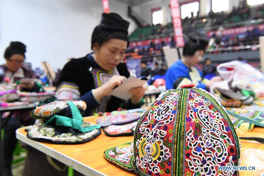 Photo taken on Nov. 15, 2018 shows an embroidery work at a manual skills competition held in Rongjiang County of Qiandongnan Miao and Dong Autonomous Prefecture, southwest China\'s Guizhou Province. A number of artisans from the county participated in the competition in aspects of spinning, weaving, wax printing, embroidery and so on. (Xinhua/Wang Bingzhen)