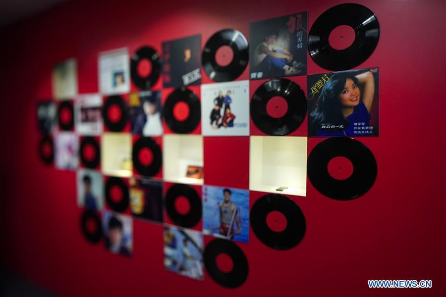 A wall of vintage vinyl records is displayed at a major exhibition to commemorate the 40th anniversary of China\'s reform and opening-up at the National Museum of China in Beijing, capital of China, Nov. 15, 2018. Vintage objects are displayed at the exhibition which opened here on Tuesday to show visitors the history, accomplishments, and experience of China\'s reform and opening-up.(Xinhua/Shen Bohan)