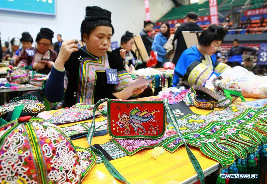 Competitors present embroidery skills during a manual skills competition held in Rongjiang County of Qiandongnan Miao and Dong Autonomous Prefecture, southwest China\'s Guizhou Province, on Nov. 15, 2018. A number of artisans from the county participated in the competition in aspects of spinning, weaving, wax printing, embroidery and so on. (Xinhua/Li Changhua)