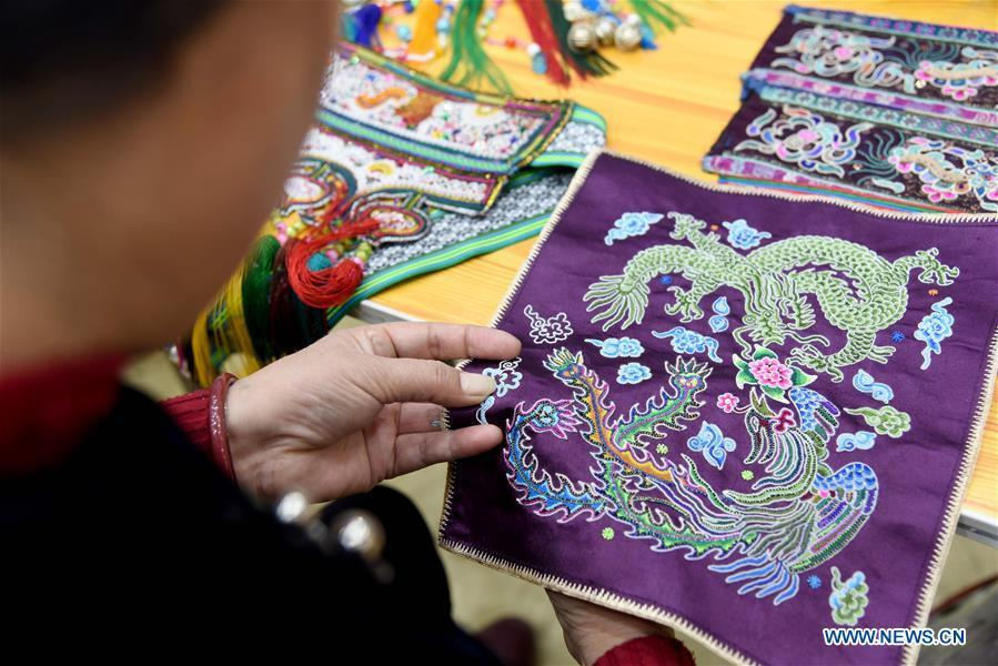 A competitor presents embroidery skills during a manual skills competition held in Rongjiang County of Qiandongnan Miao and Dong Autonomous Prefecture, southwest China\'s Guizhou Province, on Nov. 15, 2018. A number of artisans from the county participated in the competition in aspects of spinning, weaving, wax printing, embroidery and so on. (Xinhua/Liu Jinyin)
