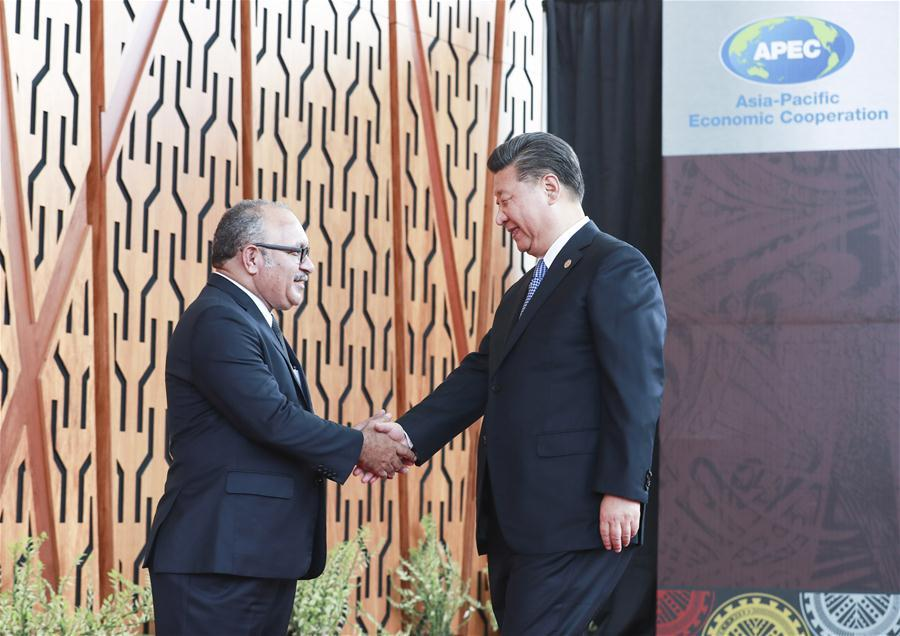 Chinese President Xi Jinping (R) is welcomed by Papua New Guinea (PNG) Prime Minister Peter O\'Neill ahead of a dialogue between APEC leaders and representatives from the APEC Business Advisory Council in Port Moresby, Papua New Guinea, on Nov. 17, 2018. Xi Jinping also delivered a keynote speech titled Jointly Charting a Course Toward a Brighter Future while attending the Asia Pacific Economic Cooperation (APEC) CEO Summit held here on Saturday. (Xinhua/Pang Xinglei)
