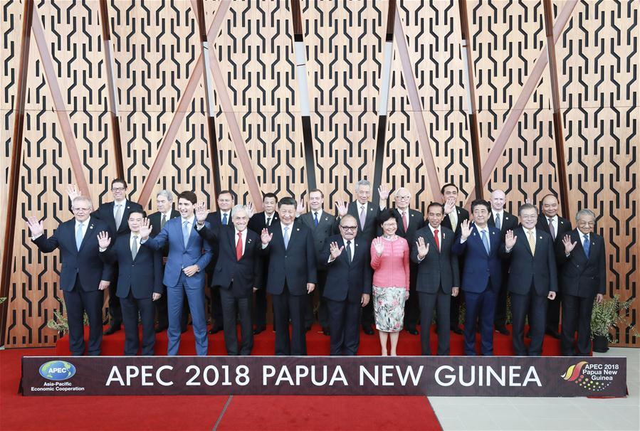 Chinese President Xi Jinping (5th L, front) and other leaders and representatives from member economies of the Asia Pacific Economic Cooperation (APEC) pose for a group photo ahead of a dialogue between APEC leaders and representatives from the APEC Business Advisory Council in Port Moresby, Papua New Guinea, on Nov. 17, 2018. Xi Jinping also delivered a keynote speech titled Jointly Charting a Course Toward a Brighter Future while attending the APEC CEO Summit held here on Saturday. (Xinhua/Pang Xinglei)