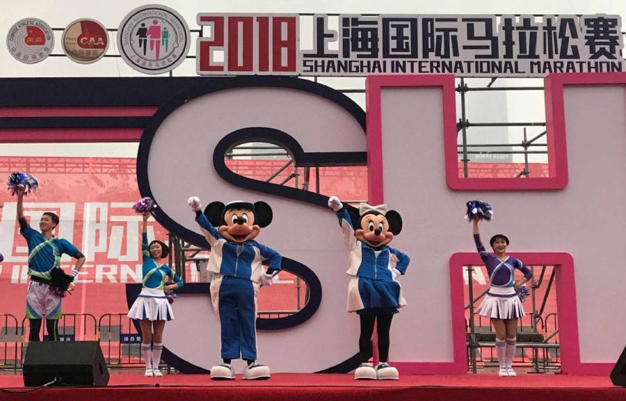 Mickey and its companion Minnie Mouse make a surprise visit to the Shanghai International Marathon on Nov. 18.