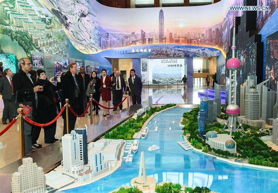 Foreign visitors view Shanghai\'s architectural models during a major exhibition to commemorate the 40th anniversary of China\'s reform and opening-up at the National Museum of China in Beijing, capital of China, Nov. 19, 2018. (Xinhua/Li He)