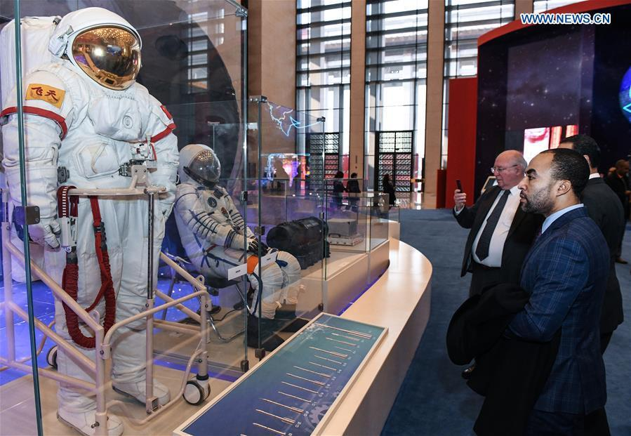 Foreign visitors view the spacesuits designed and made by China during a major exhibition to commemorate the 40th anniversary of China\'s reform and opening-up at the National Museum of China in Beijing, capital of China, Nov. 19, 2018. (Xinhua/Li He)