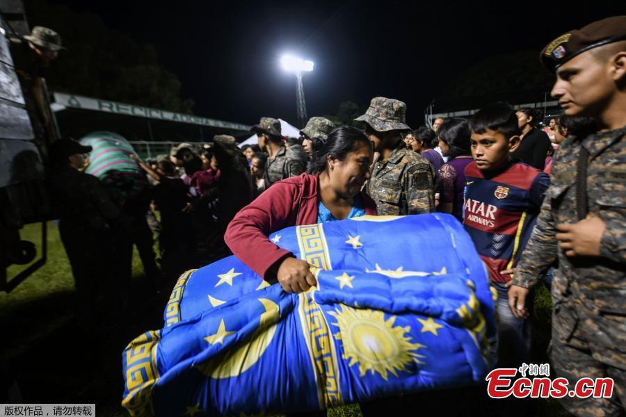 Residents of several communities nearby the erupting Fuego volcano, arrive at a temporary shelter in Escuintla department, 35 km south of Guatemala City on Nov. 19, 2018. Guatemalan authorities on Monday declared a red alert after the Fuego volcano erupted again, forcing almost 3,000 residents to flee. (Photo/Agencies)