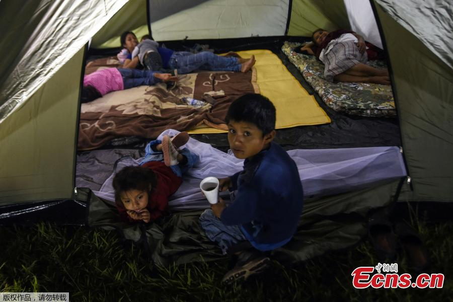 Residents of several communities nearby the erupting Fuego volcano, stay at a temporary shelter in Escuintla department, 35 km south of Guatemala City on Nov. 19, 2018. - Guatemalan authorities on Monday declared a red alert after the Fuego volcano erupted again, forcing almost 3,000 residents to flee. (Photo/Agencies)