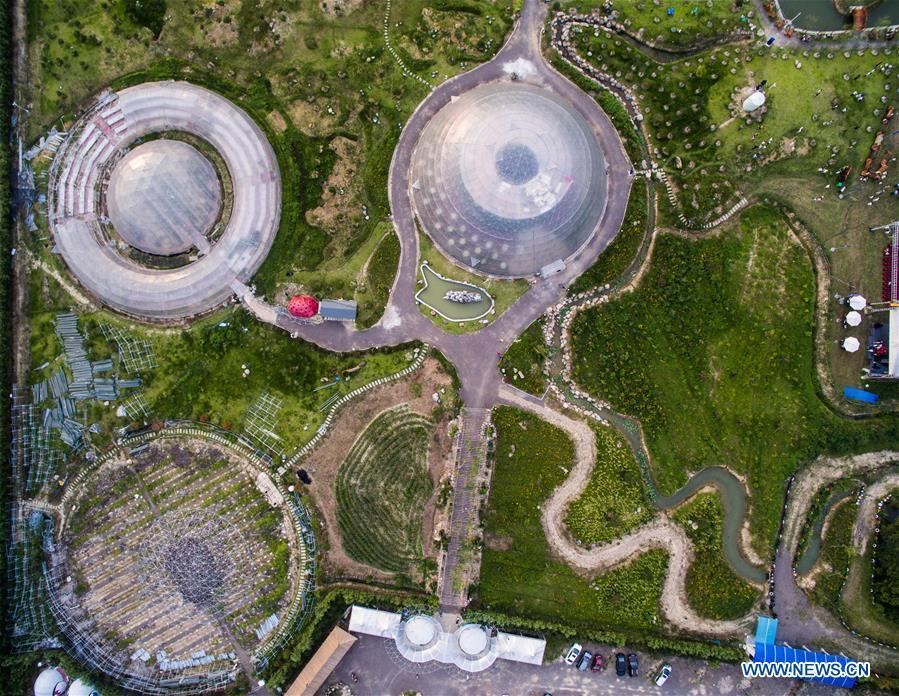 Photo taken on Aug. 1, 2015 shows an aerial view of a space-themed agricultural park hosting a tourism festival for the youth in Tiantai County, east China\'s Zhejiang Province. China is slated to become world\'s largest theme park market by 2020, when the number of tourists is expected to exceed 230 million, according to a fresh report by U.S. engineering firm AECOM. The number of tourists to Chinese theme parks have seen an average annual growth of 13 percent in the past decade, and reached 190 million in 2017. The number is expected to keep the double digit growth in the following years, according to the report. The report attributes the rapid growth to Chinese consumers\' rising income that sparks greater demands on leisure activities, as well as more convenient public transportation systems. (Xinhua/Xu Yu)