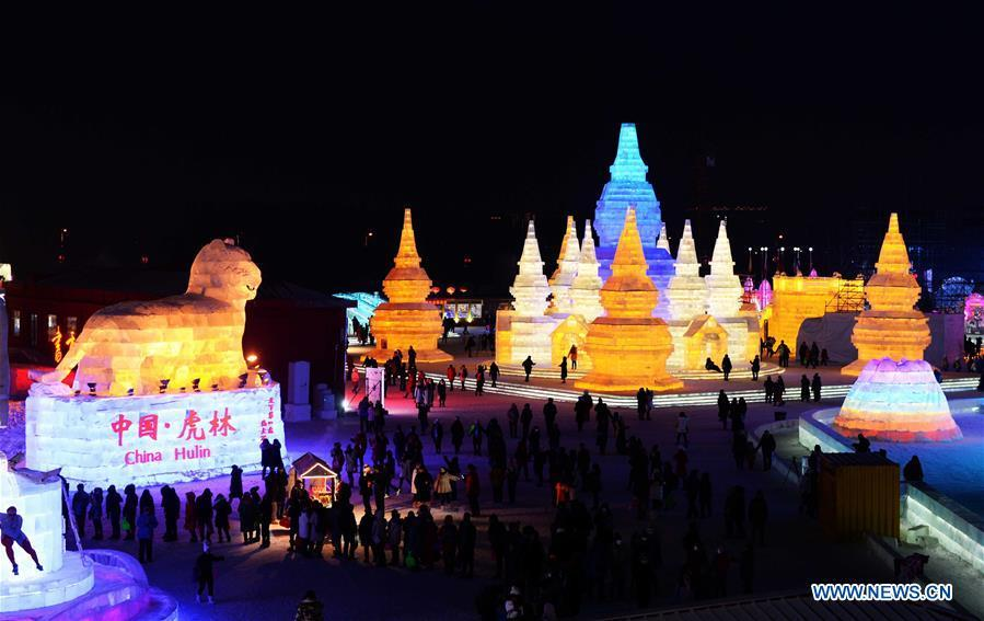 Tourists visit Harbin Ice and Snow World, northeast China\'s Heilongjiang Province, Jan. 5, 2017. China is slated to become world\'s largest theme park market by 2020, when the number of tourists is expected to exceed 230 million, according to a fresh report by U.S. engineering firm AECOM. The number of tourists to Chinese theme parks have seen an average annual growth of 13 percent in the past decade, and reached 190 million in 2017. The number is expected to keep the double digit growth in the following years, according to the report. The report attributes the rapid growth to Chinese consumers\' rising income that sparks greater demands on leisure activities, as well as more convenient public transportation systems. (Xinhua/Wang Kai)