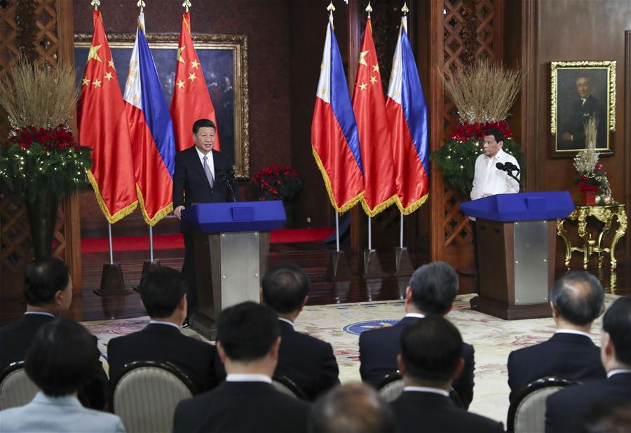 Chinese President Xi Jinping and his Philippine counterpart Rodrigo Duterte attend a joint press conference after their talks in Manila, the Philippines, Nov. 20, 2018. (Xinhua/Xie Huanchi)