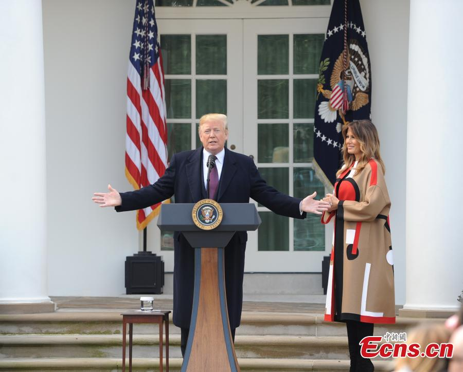 U.S. President Donald Trump (L) speaks during the National Thanksgiving Turkey Pardoning Ceremony at the Rose Garden of the White House in Washington D.C., the United States, on Nov. 20, 2018. (Photo: China News Service/ Chen Mengtong)