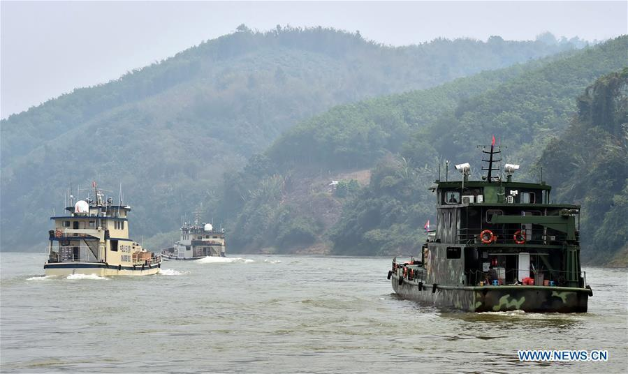 Joint patrol vessels with law enforcement personnel from China, Thailand, Laos and Myanmar, sail on the Lancang-Mekong River, March 17, 2015. The 76th Mekong River joint patrol led by China, Laos, Myanmar, and Thailand started Nov. 20, 2018 from Guanlei Port, Xishuangbanna Dai Autonomous Prefecture in southwest China\'s Yunnan Province. According to Yunnan border police bureau, the joint patrol will last five days and cover a range of over 500 kilometers to enhance anti-terrorism capability, safeguard the security and crack down on cross-border crimes. Once every month since 2011, the patrols targeting drug trafficking, smuggling and other cross-border crimes along the Mekong, conduct random inspections in waters near key regions, including the Golden Triangle.The Mekong River, known as the Lancang River at the Chinese stretch, runs through China, Laos, Myanmar, Thailand, Cambodia and Vietnam. It is an important waterway for transnational shipping and a border area known for criminal activities. For seven years, security cooperation between the four countries has been getting closer with joint patrols a regular monthly phenomenon. The patrol includes anti-terrorism drills, police skill practices and anti-drug campaigns. Since December 2011, the joint patrols have covered more than 39,500 kilometers, with 122 merchant ships rescued and 582.28 kilograms of drugs seized. The cooperation has expanded to the cracking down on terrorism and human trafficking, as well as joint search and rescue. (Xinhua/Chen Haining)