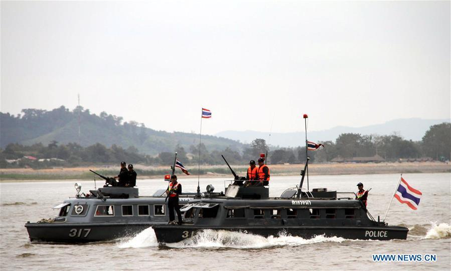 A Thai vessel patrols on the Thailand section of Mekong River, Dec. 11, 2011. The 76th Mekong River joint patrol led by China, Laos, Myanmar, and Thailand started Nov. 20, 2018 from Guanlei Port, Xishuangbanna Dai Autonomous Prefecture in southwest China\'s Yunnan Province. According to Yunnan border police bureau, the joint patrol will last five days and cover a range of over 500 kilometers to enhance anti-terrorism capability, safeguard the security and crack down on cross-border crimes. Once every month since 2011, the patrols targeting drug trafficking, smuggling and other cross-border crimes along the Mekong, conduct random inspections in waters near key regions, including the Golden Triangle.The Mekong River, known as the Lancang River at the Chinese stretch, runs through China, Laos, Myanmar, Thailand, Cambodia and Vietnam. It is an important waterway for transnational shipping and a border area known for criminal activities. For seven years, security cooperation between the four countries has been getting closer with joint patrols a regular monthly phenomenon. The patrol includes anti-terrorism drills, police skill practices and anti-drug campaigns. Since December 2011, the joint patrols have covered more than 39,500 kilometers, with 122 merchant ships rescued and 582.28 kilograms of drugs seized. The cooperation has expanded to the cracking down on terrorism and human trafficking, as well as joint search and rescue. (Xinhua/Lin Ning)