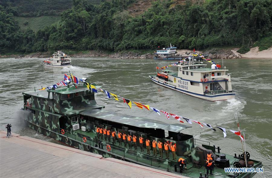 Patrol boats carrying police officers from China, Laos, Myanmar and Thailand leave Guanlei Port in Dai Autonomous Prefecture of Xishuangbanna, southwest China\'s Yunnan Province, as a joint patrol along the Mekong River kicks off on Dec. 10, 2011. The 76th Mekong River joint patrol led by China, Laos, Myanmar, and Thailand started Nov. 20, 2018 from Guanlei Port, Xishuangbanna Dai Autonomous Prefecture in southwest China\'s Yunnan Province. According to Yunnan border police bureau, the joint patrol will last five days and cover a range of over 500 kilometers to enhance anti-terrorism capability, safeguard the security and crack down on cross-border crimes. Once every month since 2011, the patrols targeting drug trafficking, smuggling and other cross-border crimes along the Mekong, conduct random inspections in waters near key regions, including the Golden Triangle.The Mekong River, known as the Lancang River at the Chinese stretch, runs through China, Laos, Myanmar, Thailand, Cambodia and Vietnam. It is an important waterway for transnational shipping and a border area known for criminal activities. For seven years, security cooperation between the four countries has been getting closer with joint patrols a regular monthly phenomenon. The patrol includes anti-terrorism drills, police skill practices and anti-drug campaigns. Since December 2011, the joint patrols have covered more than 39,500 kilometers, with 122 merchant ships rescued and 582.28 kilograms of drugs seized. The cooperation has expanded to the cracking down on terrorism and human trafficking, as well as joint search and rescue. (Xinhua/Lin Yiguang)