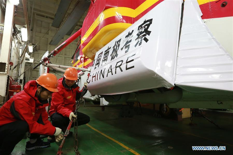 Staff members check a helicopter on China\'s research icebreaker Xuelong, also known as the Snow Dragon, on Nov. 21, 2018. The icebreaker is on China\'s 35th Antarctic research expedition. At 6:22 p.m. Wednesday (local time), Xuelong crossed the stormy westerlies on its way toward China\'s Zhongshan Station in Antarctic. (Xinhua/Liu Shiping)