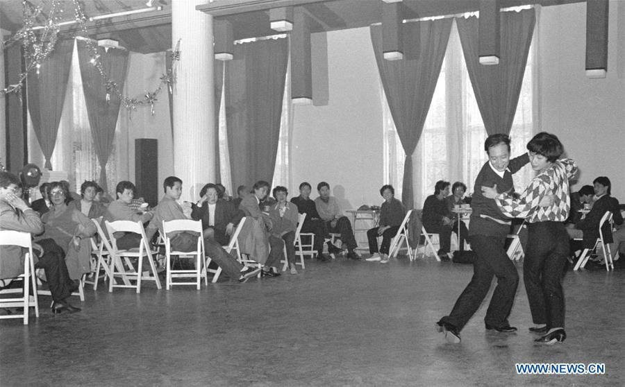 File photo issued on May 6, 1987 shows people dancing in a ballroom in east China\'s Shanghai. From 1978 when China started its reform and opening-up policy, a door to the outside world has been opened. Along with the imported commodities, fashion ideas inevitably slipped into China and since then the country, which was somewhat lack of fashion diversity, started its journey to pursue fashions. Over the past four decades, the thirst for beauty has driven Chinese people to pursue every possible fashionable element. The change first came with dress when colorful and diversified clothing prevailed as against the former dominant blue and grey. For a time, men and women raced to hairdressers\' just for trendy hairdos. Eating McDonald\'s or western cuisine even once was regarded as a fashionable thing. However, the most conspicuous change is that Chinese people have become more inclusive and they tend to accept new fashions, styles and concepts. China nowadays is dazzling the world not only on the fashion stage but in many other fields. Changes in fashions, as a profile of society, has well interpreted the benefits to people brought by China\'s reform and opening-up policy. (Xinhua/Yang Putao)