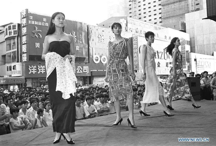 File photo taken in 1995 shows models presenting fashion creations at a shopping mall in Shenyang, northeast China\'s Liaoning Province. From 1978 when China started its reform and opening-up policy, a door to the outside world has been opened. Along with the imported commodities, fashion ideas inevitably slipped into China and since then the country, which was somewhat lack of fashion diversity, started its journey to pursue fashions. Over the past four decades, the thirst for beauty has driven Chinese people to pursue every possible fashionable element. The change first came with dress when colorful and diversified clothing prevailed as against the former dominant blue and grey. For a time, men and women raced to hairdressers\' just for trendy hairdos. Eating McDonald\'s or western cuisine even once was regarded as a fashionable thing. However, the most conspicuous change is that Chinese people have become more inclusive and they tend to accept new fashions, styles and concepts. China nowadays is dazzling the world not only on the fashion stage but in many other fields. Changes in fashions, as a profile of society, has well interpreted the benefits to people brought by China\'s reform and opening-up policy. (Xinhua/Li Yonghong)