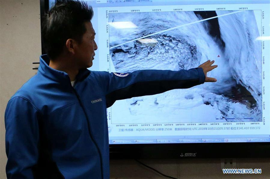 Captain of China\'s research icebreaker Xuelong works on the ship on Nov. 21, 2018. The icebreaker, also known as the Snow Dragon, is on China\'s 35th Antarctic research expedition. At 6:22 p.m. Wednesday (local time), Xuelong crossed the stormy westerlies on its way toward China\'s Zhongshan Station in Antarctic. (Xinhua/Liu Shiping)