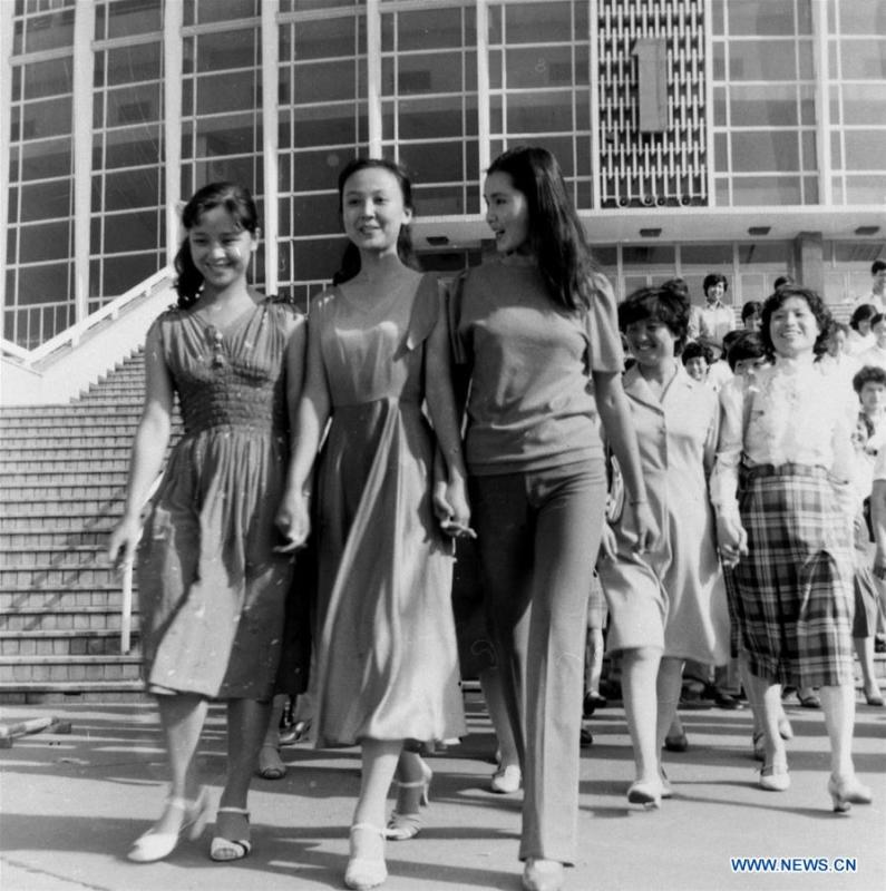 File photo shows a stage photo of a movie in 1984, which tells a story about female model worker and beautiful skirt. From 1978 when China started its reform and opening-up policy, a door to the outside world has been opened. Along with the imported commodities, fashion ideas inevitably slipped into China and since then the country, which was somewhat lack of fashion diversity, started its journey to pursue fashions. Over the past four decades, the thirst for beauty has driven Chinese people to pursue every possible fashionable element. The change first came with dress when colorful and diversified clothing prevailed as against the former dominant blue and grey. For a time, men and women raced to hairdressers\' just for trendy hairdos. Eating McDonald\'s or western cuisine even once was regarded as a fashionable thing. However, the most conspicuous change is that Chinese people have become more inclusive and they tend to accept new fashions, styles and concepts. China nowadays is dazzling the world not only on the fashion stage but in many other fields. Changes in fashions, as a profile of society, has well interpreted the benefits to people brought by China\'s reform and opening-up policy. (Xinhua)
