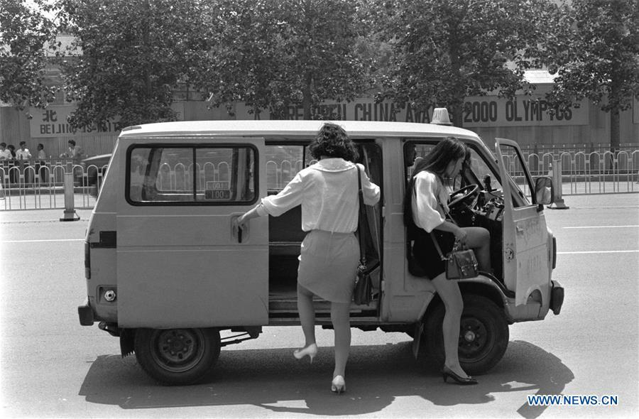 File photo taken in 1993 shows two young ladies getting on a taxi in Beijing, capital of China. From 1978 when China started its reform and opening-up policy, a door to the outside world has been opened. Along with the imported commodities, fashion ideas inevitably slipped into China and since then the country, which was somewhat lack of fashion diversity, started its journey to pursue fashions. Over the past four decades, the thirst for beauty has driven Chinese people to pursue every possible fashionable element. The change first came with dress when colorful and diversified clothing prevailed as against the former dominant blue and grey. For a time, men and women raced to hairdressers\' just for trendy hairdos. Eating McDonald\'s or western cuisine even once was regarded as a fashionable thing. However, the most conspicuous change is that Chinese people have become more inclusive and they tend to accept new fashions, styles and concepts. China nowadays is dazzling the world not only on the fashion stage but in many other fields. Changes in fashions, as a profile of society, has well interpreted the benefits to people brought by China\'s reform and opening-up policy. (Xinhua)