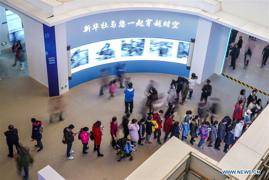 Visitors view photo gallery made by Xinhua News Agency during a major exhibition to commemorate the 40th anniversary of China\'s reform and opening-up at the National Museum of China in Beijing, capital of China, Nov. 24, 2018. (Xinhua/Yin Gang)