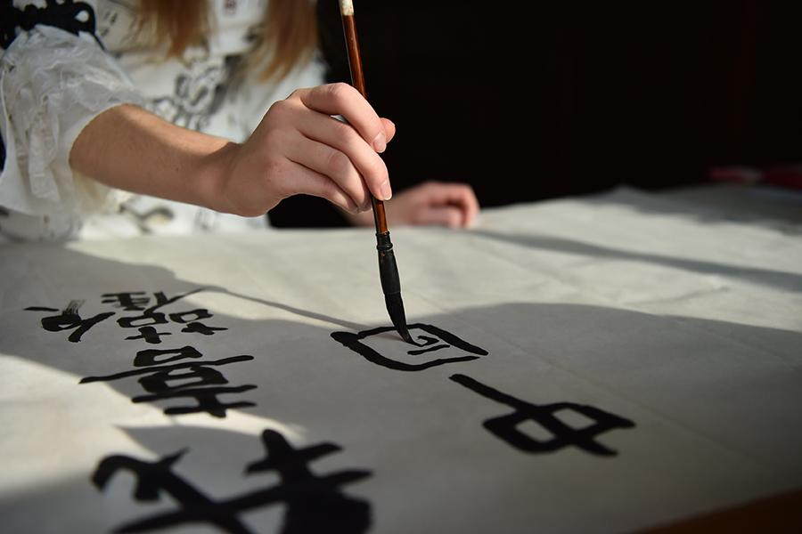 Francis practices calligraphy at home. (Photo/Xinhua)