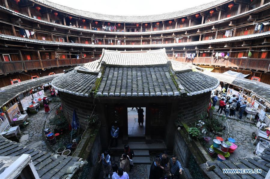 Photo taken on Nov. 23, 2018 shows interior structure of Huaiyuan Tulou in Kanxia Village in Nanjing County of Zhangzhou City, southeast China\'s Fujian Province. Fujian Tulou, which dates back to Song and Yuan dynasties, is a type of Chinese rural dwellings of the Hakka people in the mountainous areas in Fujian Province. The layout of Fujian Tulou followed the Chinese dwelling tradition of \