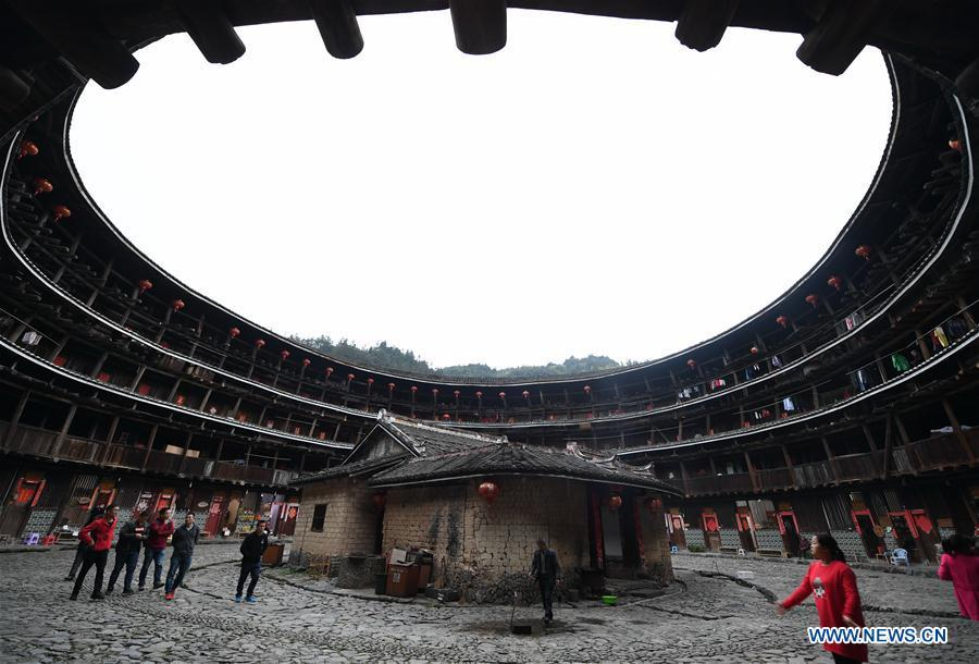 Photo taken on Nov. 23, 2018 shows Yuchang Tulou in Zhangzhou City, southeast China\'s Fujian Province. Fujian Tulou, which dates back to Song and Yuan dynasties, is a type of Chinese rural dwellings of the Hakka people in the mountainous areas in Fujian Province. The layout of Fujian Tulou followed the Chinese dwelling tradition of \