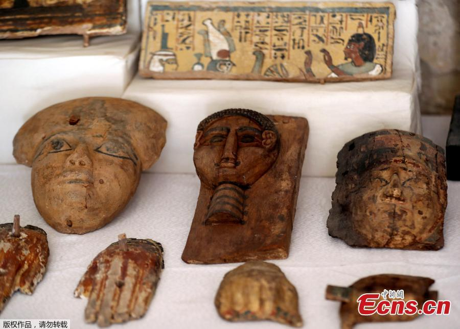 Wooden masks are displayed outside the newly discovered tomb at al-Assassif Necropolis in Luxor, Egypt November 24, 2018.