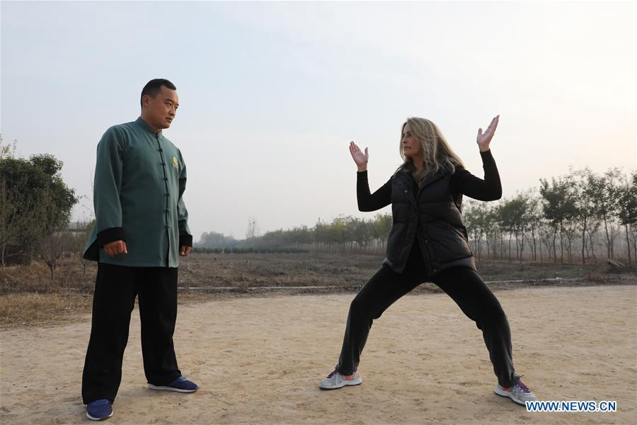 Ana Fidalgo (R) practices Taiji under the guidance of coach Chen Chao in Chenjiagou Village of Wenxian County, central China\'s Henan Province, Nov. 25, 2018. Ana, who comes from Sao Paulo, Brazil, loves Chinese culture, and is a fan of Taiji. It\'s the third time that she comes to Chenjiagou Village to study Taiji. She has taught what she has learned in China in her hometown when coming back to Brazil in recent years, hoping to benefit more people. (Xinhua/Xu Hongxing)