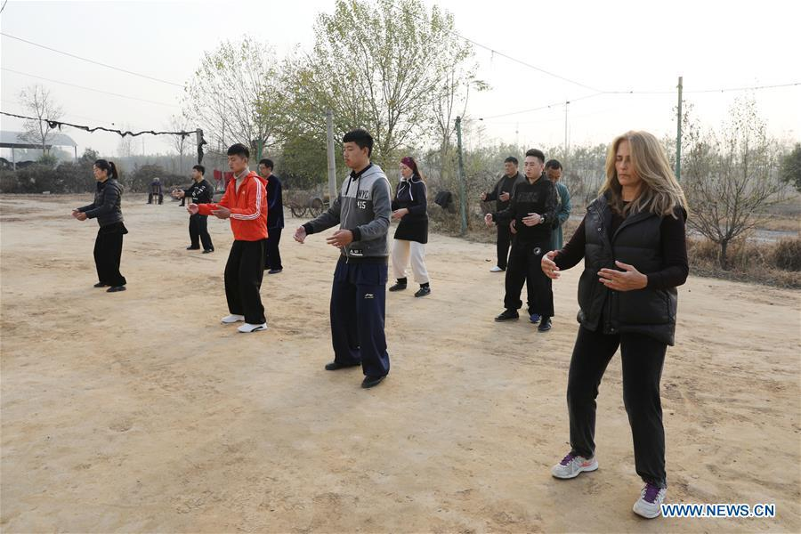 Ana Fidalgo (1st R) practices Taiji with other students in Chenjiagou Village of Wenxian County, central China\'s Henan Province, Nov. 25, 2018. Ana, who comes from Sao Paulo, Brazil, loves Chinese culture, and is a fan of Taiji. It\'s the third time that she comes to Chenjiagou Village to study Taiji. She has taught what she has learned in China in her hometown when coming back to Brazil in recent years, hoping to benefit more people. (Xinhua/Xu Hongxing)