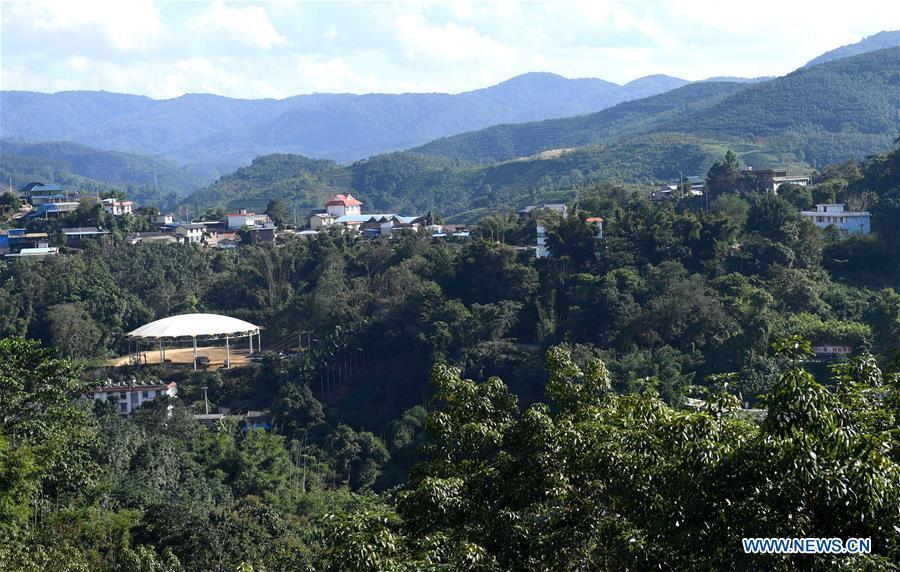 Aerial photo taken on Nov. 20, 2018 shows a view of the Jino Ethnic Township on Jino Mountain in Jinghong of Xishuangbanna Dai Autonomous Prefecture, southwest China\'s Yunnan Province. With a population of slightly over 20,000, the Jino people had only been officially acknowledged in 1979 as an independent ethnic group of China. Until 1949, most of them had lived for generations in primitive mountain tribes in southwest China\'s Yunnan Province. Over the four decades since it embraced the reform and opening-up policy, China has spared no effort to support ethnic groups with smaller populations. Life on Jino Mountain, where most Jino communities are located, saw positive changes in parallel with improvements in local politics, economy, technology, education, culture, health care, ecology, ethnic development and other social undertakings. Just like its 55 ethnic brethren, the Jino people also benefit from China\'s reform and opening-up in seeking a prosperous life. In Jino Ethnic Township on the Jino Mountain, residents now have direct access to road, water, electricity, TV and radio, as well as the mobile network. Ninety percent of the residents have moved into new houses. Most residents own motorcycles and tractors, and some of them have purchased cars. More people have increased their income by selling local specialty products via the internet, whereas in the past, doing business was perceived as a shame. Currently, the primary education in Jino Ethnic Township achieved 100 percent coverage for all school-age children. More than 99 percent of residents have joined the rural cooperative medical insurance programme. The Jino ethnic culture undergoes protection and inheritance: the great drum dance of the Jino people has been listed as one of China\'s national intangible cultural heritages. (Xinhua/Lin Yiguang)