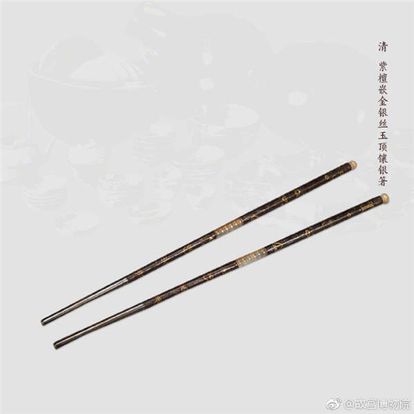 A pair of chopsticks made of red sandalwood inlaid with metallic yarn and jade, from the Qing Dynasty. (Photo/Official Weibo account of the Palace Museum)
