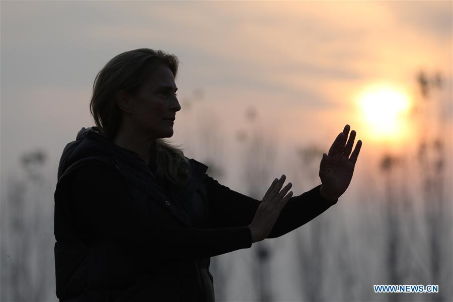 Ana Fidalgo practices Taiji in Chenjiagou Village of Wenxian County, central China\'s Henan Province, Nov. 25, 2018. Ana, who comes from Sao Paulo, Brazil, loves Chinese culture, and is a fan of Taiji. It\'s the third time that she comes to Chenjiagou Village to study Taiji. She has taught what she has learned in China in her hometown when coming back to Brazil in recent years, hoping to benefit more people. (Xinhua/Xu Hongxing)