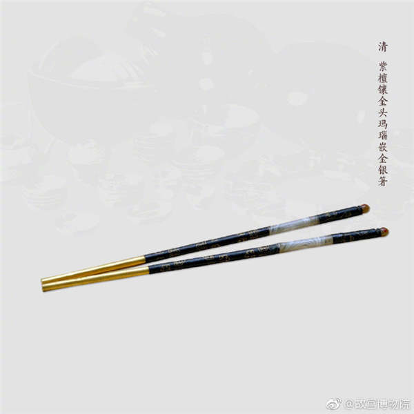 A pair of chopsticks made of red sandalwood inlaid with gold and agate, from the Qing Dynasty. (Photo/Official Weibo account of the Palace Museum)