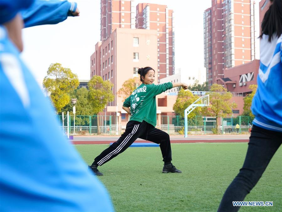 Teacher Zeng Wenping (C) instructs students in martial arts at Qiyin school in Nanchang, capital of east China\'s Jiangxi Province, Nov. 26, 2018. Zeng, 43, has been engaged in special education for 21 years ever since she graduated from university. Hearing impaired students enjoy the all-encompassing heartfelt and intensive care by Zeng and consider her as more than a teacher but a sister. (Xinhua/Hu Chenhuan)