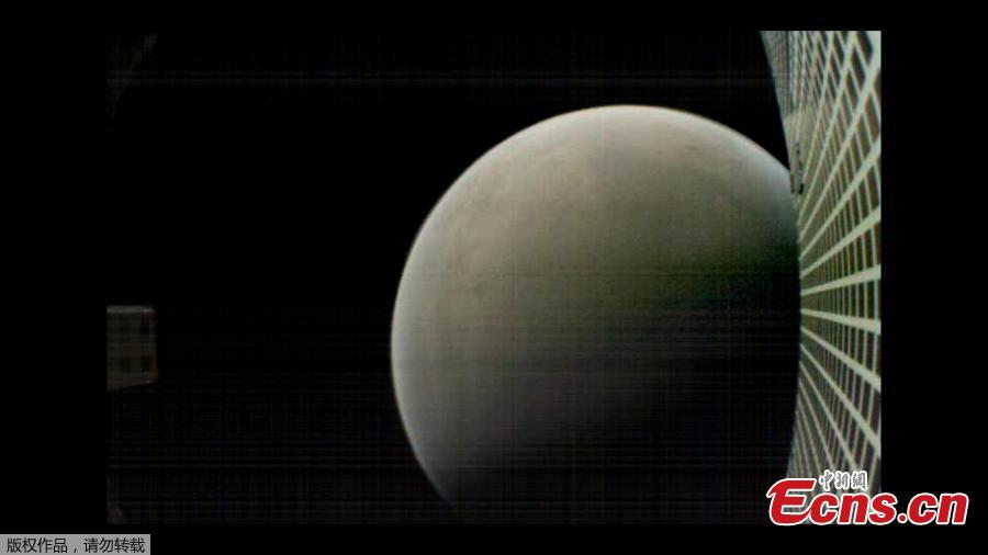 MarCO-B, one of the experimental Mars Cube One (MarCO) CubeSats, took this image of Mars from about 6,000 kilometers away during its flyby of the Red Planet on November 26, 2018.   (Photo/Agencies)