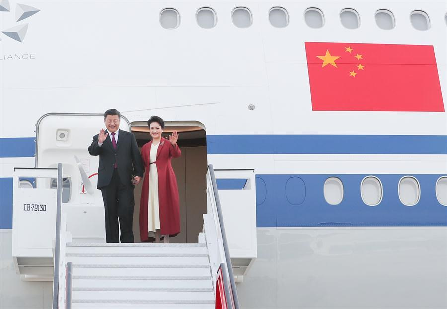 Chinese President Xi Jinping and his wife, Peng Liyuan, disembark from the plane in Madrid, Spain, Nov. 27, 2018. Xi Jinping arrived in Spain on Tuesday for a three-day state visit. (Xinhua/Xie Huanchi)