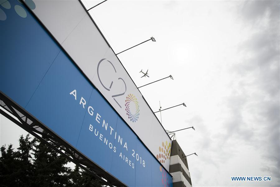 A plane flies above the Costa Salguero Center in Buenos Aires, Argentina, on Nov. 27, 2018. The 13th G20 summit, under the theme of Building Consensus for Fair and Sustainable Development, will be held for the first time in a South American country from Friday to Saturday. (Xinhua/Li Ming)