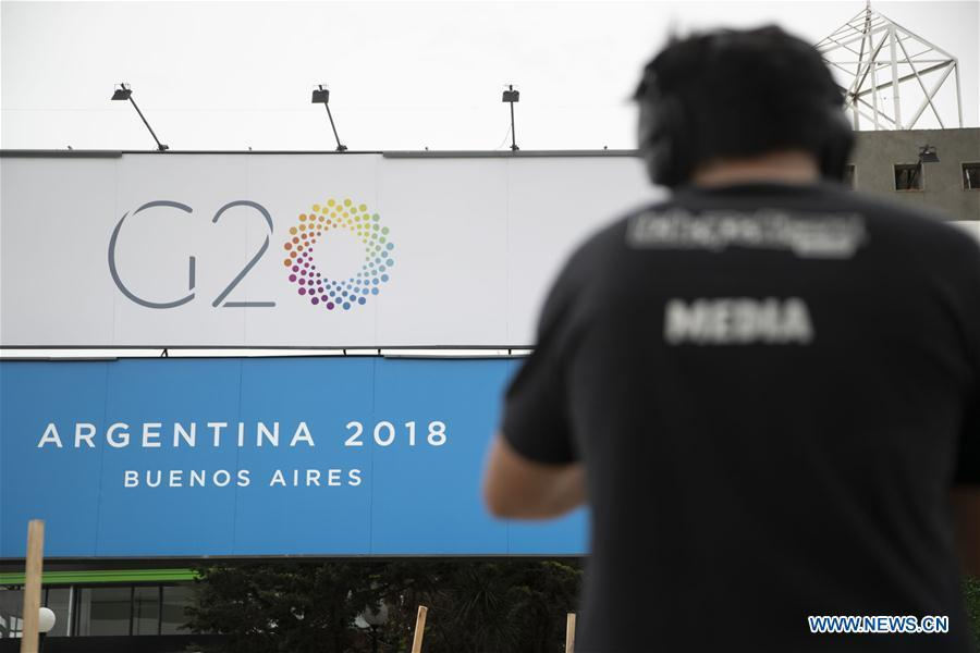 A cameraman works outside the Costa Salguero Center in Buenos Aires, Argentina, on Nov. 27, 2018. The 13th G20 summit, under the theme of Building Consensus for Fair and Sustainable Development, will be held for the first time in a South American country from Friday to Saturday. (Xinhua/Li Ming)
