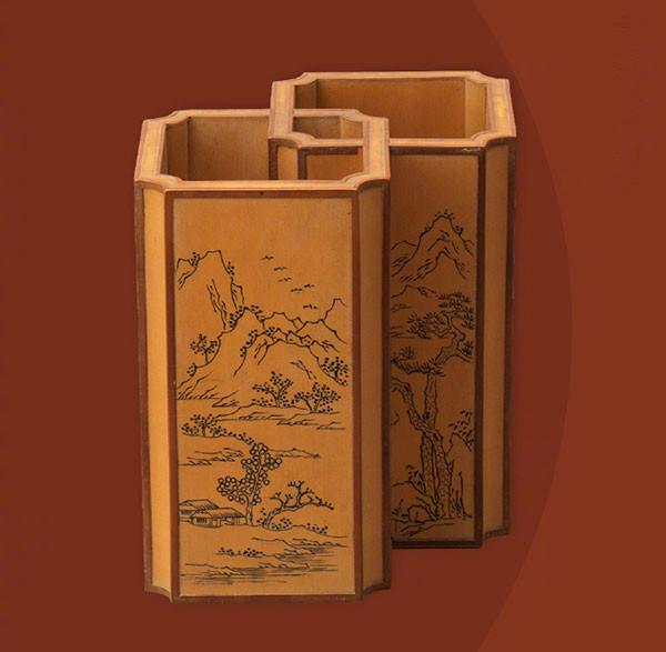A bamboo paired brush pot engraved with landscape paintings from the Qianlong Period of the Qing Dynasty.  (Photo/Official Weibo account of the Palace Museum)