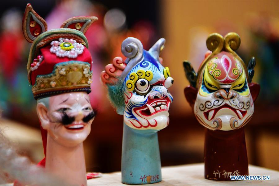 Photo taken on Nov. 28, 2018 shows wood puppet heads by Xu Zhuchu, a national-level intangible cultural heritage inheritor of Zhangzhou wood puppet head carving in Zhangzhou City, southeast China\'s Fujian Province. Listed as one of the national intangible cultural heritages in 2006, Zhangzhou wood puppet carving features exquisite craftsmanship. Xu\'s works of puppet head carving are known for rich and delicate facial expressions. Nowadays, Xu and his son, Xu Qiang, set up a studio of wood puppet to popularize local puppet culture. (Xinhua/Wei Peiquan)